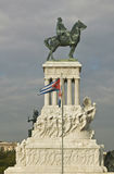 Monument to Maximo Gomez with Cuban flag blowing in the wind in Old Havana, Cuba royalty free stock images