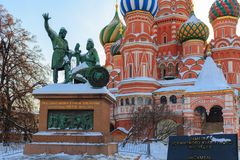 Monument to Minin and Pozharsky against St. Basil`s Cathedral. Moscow in winter Royalty Free Stock Images