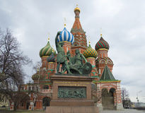 Monument to Minin and Pozharsky on the background of St. Basil`s Cathedral. Moscow Stock Photos