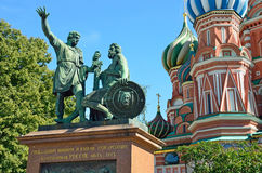 Monument to Minin and Pozharsky on the background of St. Basil`s Cathedral, Moscow, Russia. Monument to Minin and Pozharsky on the background of St. Basil`s royalty free stock photo