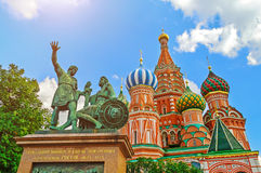 The monument to Minin and Pozharsky on the background of St. Basil`s Cathedral at the Red Square in Moscow, Russia. Stock Photo