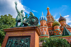Monument to Minin and Pozharsky. Monument to citizen Minin and prince Pozharsky on Red Square of Moscow, Russia, against the background of St. Basil's cathedral Stock Photo