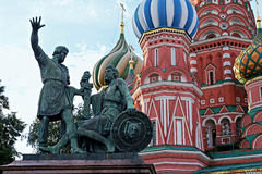 The monument to Minin and Pozharsky and Saint Basil`s Cathedral in Moscow, Russia. The monument to Minin and Pozharsky and famous Saint Basil`s Cathedral on the Stock Photos