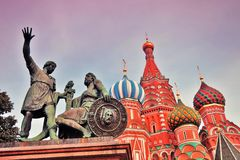 Monument to Minin and Pozharsky on the Red Square in Moscow. Monument to Minin and Pozharsky and Saint Basil`s cathedral on the Red Square in Moscow. Popular Royalty Free Stock Photography