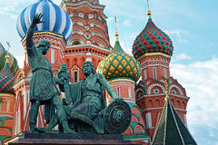 The monument to Minin and Pozharsky and Saint Basil`s Cathedral in Moscow, Russia. The monument to Minin and Pozharsky and famous Saint Basil`s Cathedral on the Stock Photo