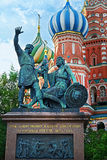 The monument to Minin and Pozharsky and Saint Basil`s Cathedral in Moscow, Russia. The monument to Minin and Pozharsky and famous Saint Basil`s Cathedral on the Royalty Free Stock Image