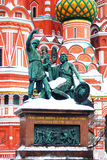 Monument to Minin and Pozharsky. St. Basil Cathedral and a monument to Russian historical figures, Kuzma Minin and Dmitry Pozharskiy, in winter. Red Square Royalty Free Stock Images