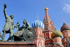 Monument to Minin and Pozharsky and St. Basil`s Cathedral. Red Square sights in Moscow: a monument to Minin and Pozharsky against the background of St. Basil`s Stock Photos