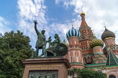 Monument to Minin and Pozharsky. St Basils cathedral and monument to Minin and Pozharsky on Red Square in Moscow Russia Stock Image