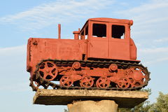 Monument to the old diesel tractor. Agricultural machinery. Monument to the old diesel tractor Stock Photography
