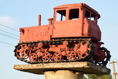 Monument to the old diesel tractor. Agricultural machinery. Monument to the old diesel tractor Royalty Free Stock Photos