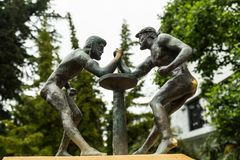 Two ancient wrestlers are engaged in arm-wrestling. Stock Images