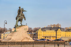Monument to Peter the Great known as the Bronze Horseman on the background of the Menshikov Palace in St. Petersburg Royalty Free Stock Photo