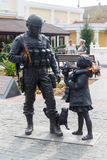 Monument to the Polite people. Simferopol, Crimea. Girl gives flowers to soldiers royalty free stock images