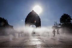 Monument to the Revolution. Children have fun at the Fountains of the Monument to the Revolution, in the Mexico City. Niños se divierten en las fuentes del stock image