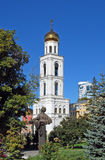Monument to A. S. Pushkin and belltower of Iversky Monastery in the clear sunny day. Samara. View of a monument to A. S. Pushkin and belltower of Iversky Royalty Free Stock Images
