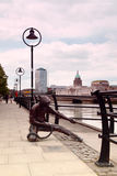Monument to sailor on banks of River Liffey Stock Image