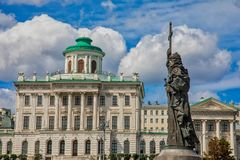 The monument to Saint Prince Vladimir baptist of Rus on the Borovitskaya square. Monument to Saint Prince Vladimir on Borovitskaya square and Pashkov House royalty free stock photography
