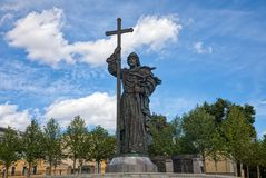 The monument to Saint Prince Vladimir baptist of Rus on the Borovitskaya square. Monument to Saint Prince Vladimir on Borovitskaya square and Pashkov House royalty free stock photo