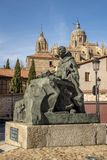 Monument to San Juan de la Cruz and in the background the cathedral of Salamanca royalty free stock photos
