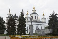 Monument to Semyon Ivanovich Dezhnev against the background of the Cathedral of the Assumption of the Blessed Virgin Mary Royalty Free Stock Images