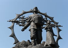 A monument to the settlers in the Altai on the square of October in Barnaul. BARNAUL, RUSSIA - JULY 2, 2015: A monument to the settlers in the Altai on the Stock Image