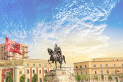 Monument to Skanderbeg in Scanderbeg Square in the center of Tirana, Albania. On a sunny day royalty free stock photo