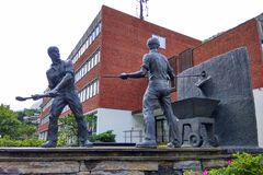 The monument to smelters in Odda, Norway. Odda, Norway - June 19, 2018: The monument `Smeltaren` by Oddmund Raudberget, dedicated to workers of local zinc stock photo