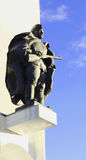 The monument to the soldier. On a high pedestal on the background of blue sky Royalty Free Stock Photography