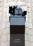 The monument to the Soviet radio announcer Yuri Levitan on the building of Central post office in Volgograd. Royalty Free Stock Photo
