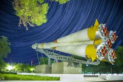 Monument to the Soyuz rocket. Startrails background. royalty free stock image
