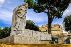 Catharina. Monument to st. Caterina of Siena with the Saint Angelo castle in the background stock photos