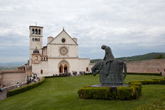 Monument to St. Francis on the background of St. Francis in Assisi. Italy. Stock Images