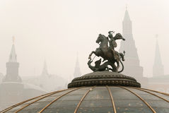 Monument to St. George with Kremlin. Towers in Moscow under smog, Russia Stock Photos