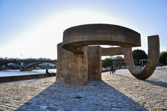 Monument to Tolerance and Triana Bridge in Seville, Spain Stock Photos