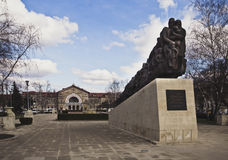 Monument to victims of communist regime, Chisinau, Moldova. A monument to the victims of the totalitarian communist regime and building of train station on Stock Photography