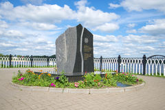 Monument to victims of radiation catastrophes on the background of the cloudy sky on a summer day. RYBINSK, RUSSIA - JULY 16, 2016: Monument to victims of Stock Images