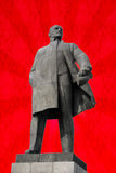 Monument to Vladimir Lenin - leader of the Russian revolution. Monument to Vladimir Lenin - leader of the Russian revolution on red background Stock Image