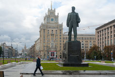 Monument to Vladimir Mayakovsky poet and Pekin hotel building in. MOSCOW - OCTOBER 8: Monument to Vladimir Mayakovsky poet and Pekin hotel building on Stock Photography
