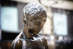 Monument of unknown boy. Looks sad and thoughtful Stock Photo