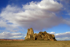 Monument Valley 10. A rain cloud hovers over one of the fantastical rock formations at Monument Valley Tribal Park in Utah and Arizona Royalty Free Stock Photo