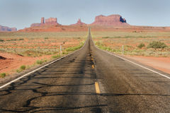 Straight desert highway road. Long straight empty desert highway road Stock Image