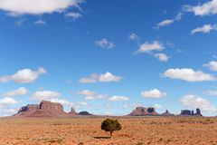 Monument Valley in Arizona with blue sky and clouds stock photography