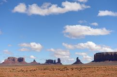 Monument Valley in Arizona with blue sky and clouds royalty free stock photos