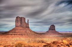Monument Valley. Wispy clouds over Monument Valley in Arizona.  This is where all the old Westerns were filmed back in John Wayne's time Stock Photo
