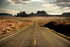 Monument Valley. Road to the Monument Valley at the sunset with clouds Stock Photography