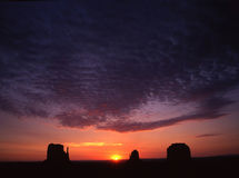 Monument Valley. Buttes, sun and clouds at sunrise in Monument Valley, Arizona Stock Photos