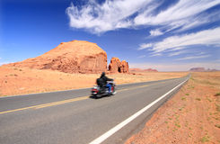 Monument Valley. Motorcycle on road in Monument Valley Stock Photos