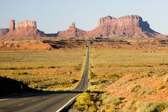 Into Monument Valley. Long straight highway into Monument Valley in Utah Royalty Free Stock Image