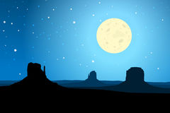Monument Valley Arizona Agaist a Starry Night Sky, EPS10 Vector. Silhouette of the rock formations of Monument Valley Arizona, USA against a blue moon-lit starry royalty free illustration